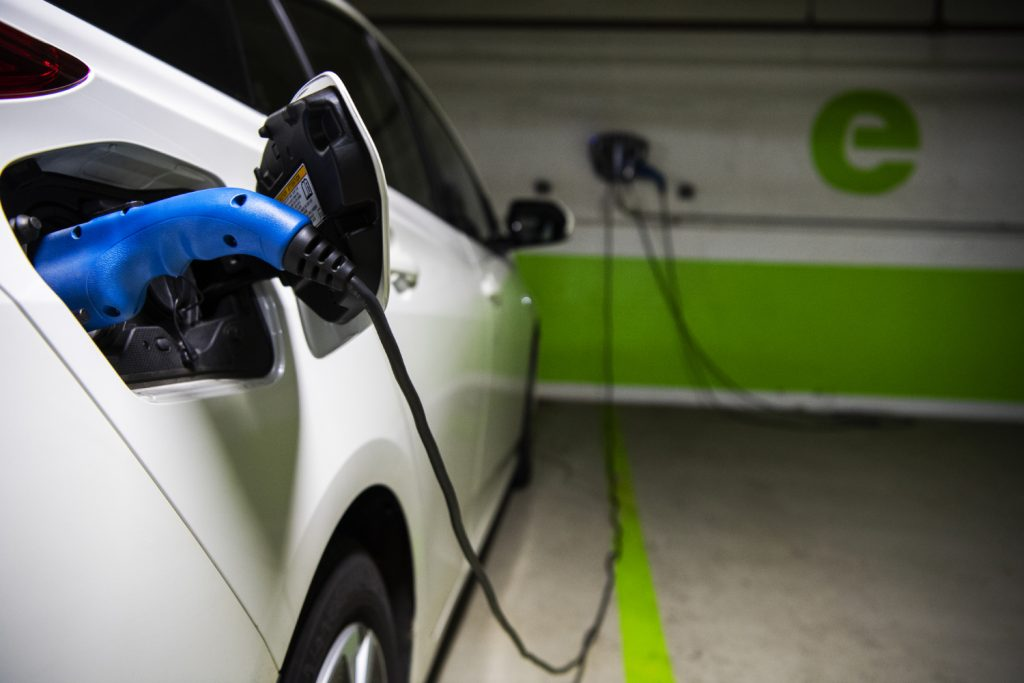 An electric vehicle plugged in to charge