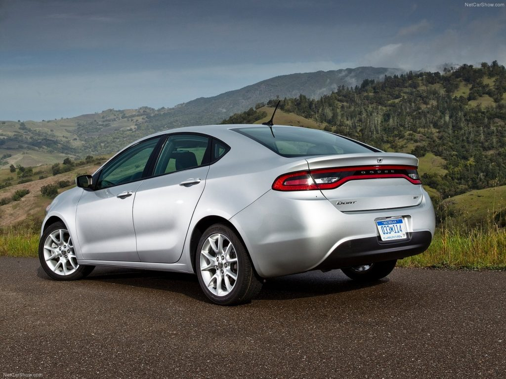 An image of a Dodge Dart parked outside.