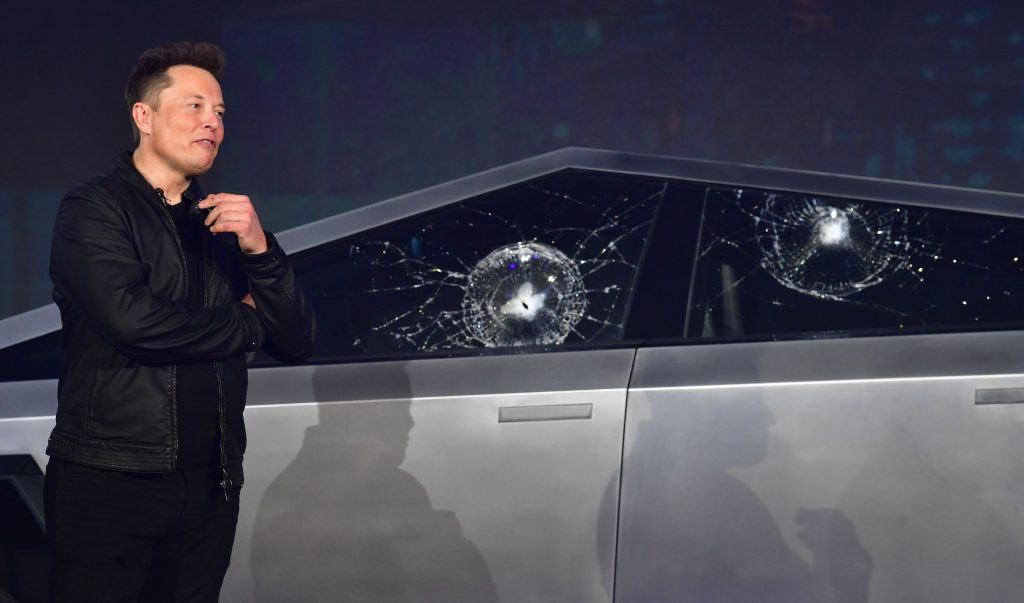 Elon musk standing in front of a Tesla Cybertruck