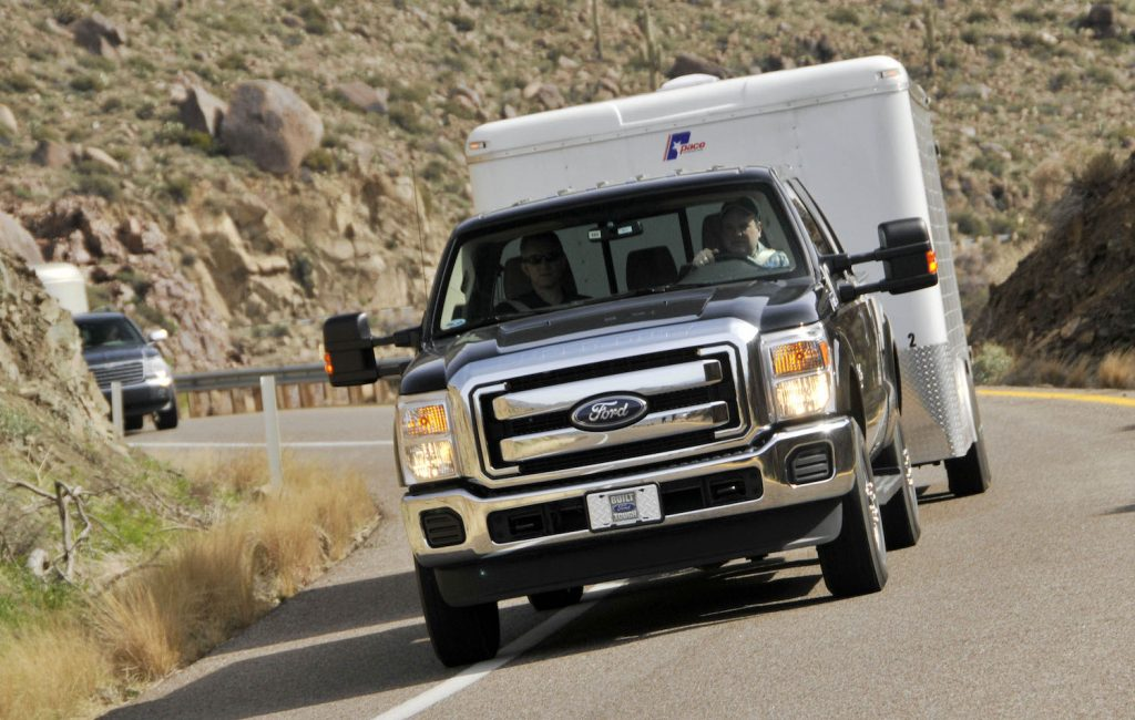 Ford's 2011 F250 Super Duty Power Stroke Diesel pickup truck is photographed pulling a 17,000-pound utility trailer up a mountain grade during a media unveiling in Yarnell, Arizona, U.S., on Tuesday, March 2, 2010.