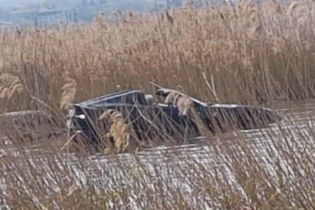 Ferrari 812 in Lake Garda seen through weeds