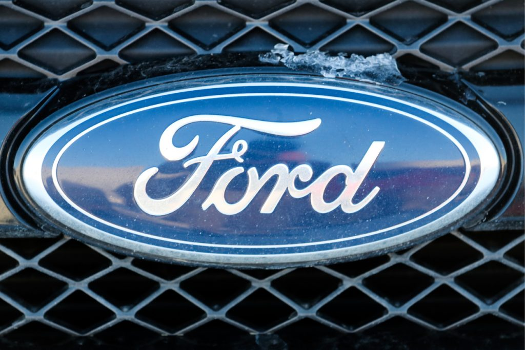 A Ford logo on the front grille of an Explorer