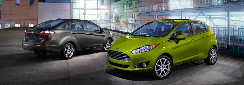 Gray Ford Fiesta sedan and green hatchback