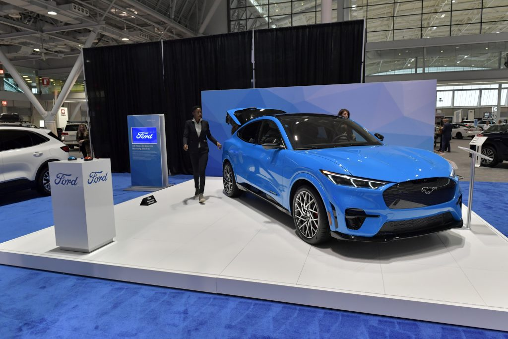 A blue electric Ford Mustang Mach-E is seen at the 2020 New England Auto Show Press Preview at Boston Convention & Exhibition Center
