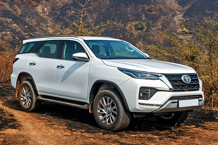 The 2021 Toyota Fortuner driving on a dirt road