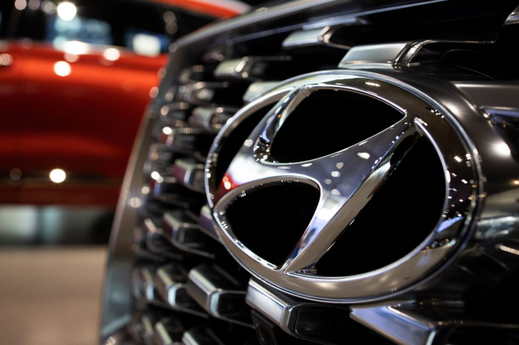 The Hyundai logo seen on the front grille of a Palisade