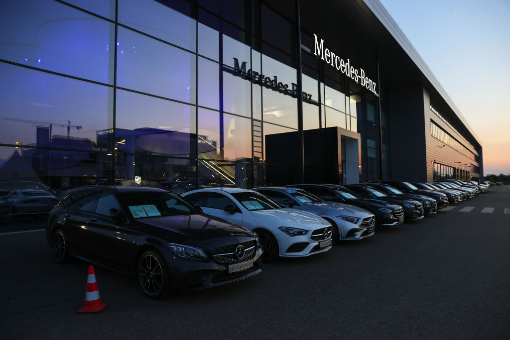 A Mercedes-Benz sales facility with new models parked neatly out front, ready for test driving