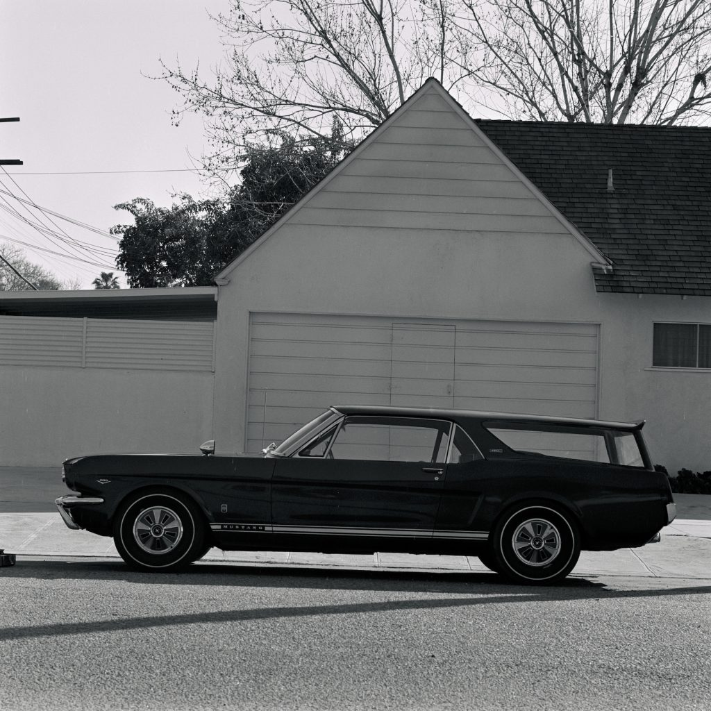 An image of a Ford Mustang Station Wagon parked outside.
