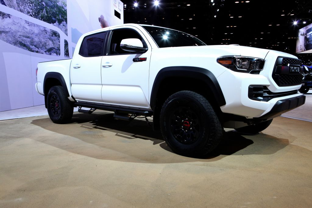 a white and 2017 Toyota Tacoma TRD Pro on display at an auto show