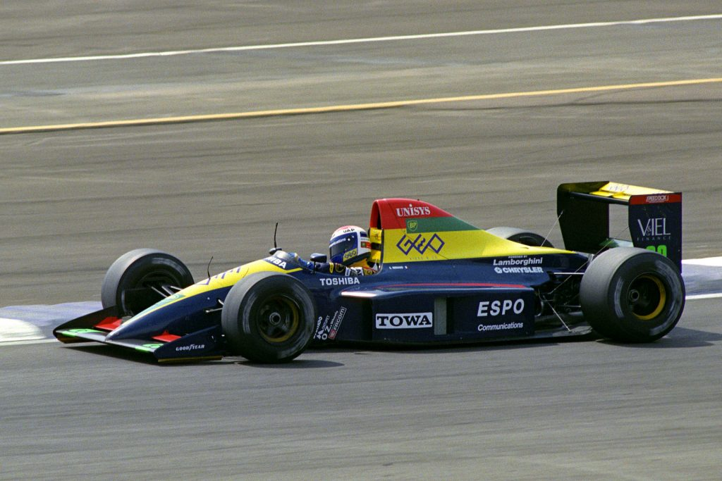 An image of a Lamborghini-powered Formula 1 car out on a track.