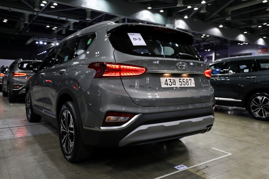 A gray Hyundai Motor Co. Santa Fe sport utility vehicle (SUV) stands on display during a launch event for the updated vehicle