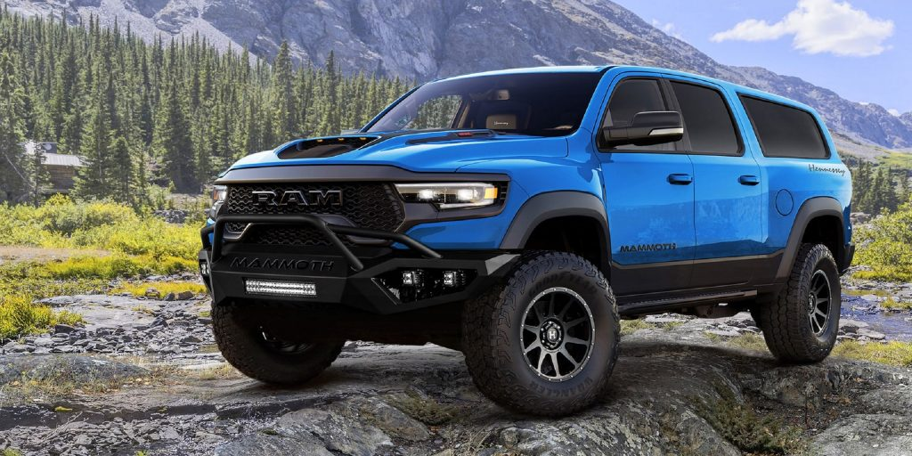 A blue Hennessey Mammoth 1000 SUV in the mountains