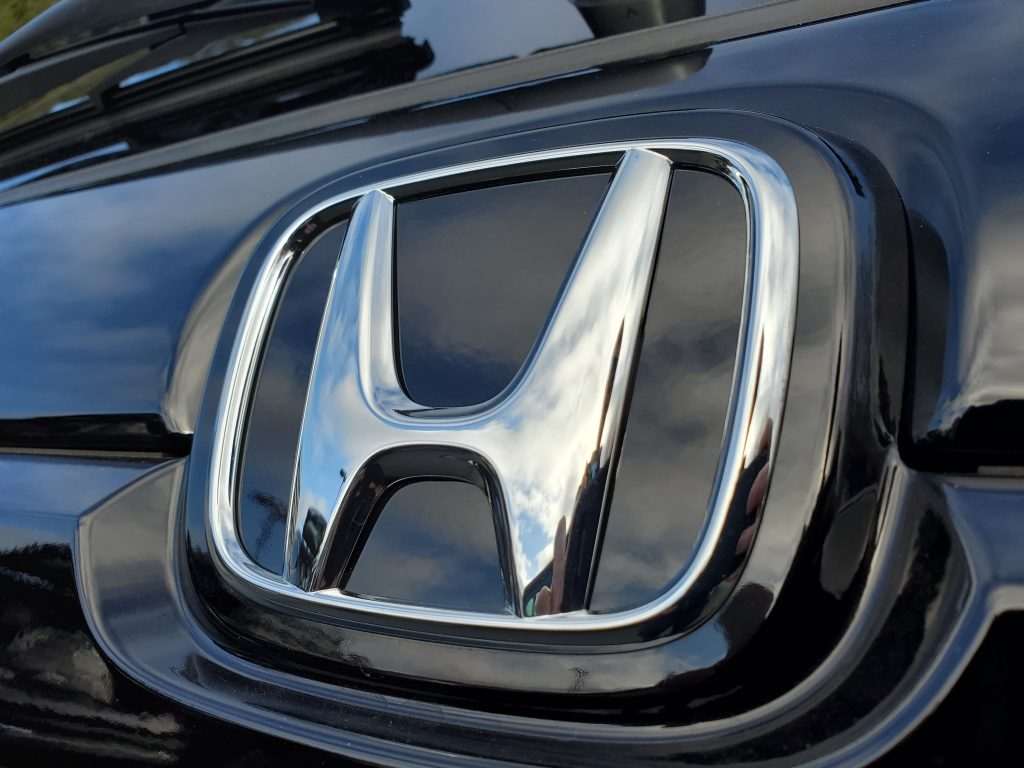 Close-up of Honda logo on hood ornament of a car