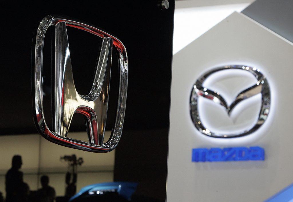 Honda and Mazda logos on display