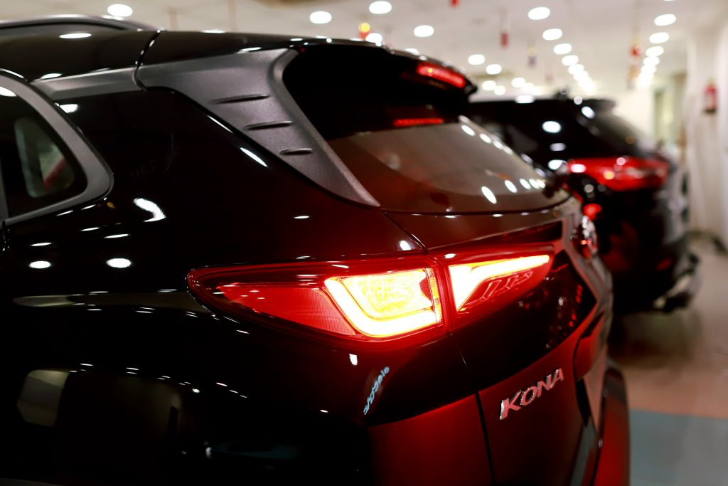 A black Hyundai Motor Co. Kona electric vehicle stands on display with other vehicles at the company's Koncept Hyundai showroom