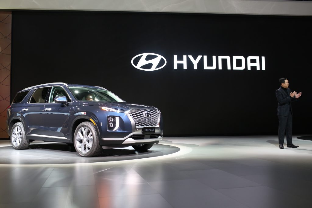 Sangyup Lee, senior vice president and head of design at Hyundai Motor Co., speaks while standing next to the Hyundai Palisade sports utility vehicle (SUV) during AutoMobility LA