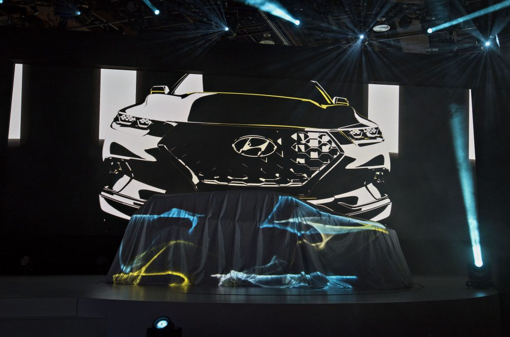 A Hyundai Motor Co. Santa Cruz Concept vehicle sits under a sheet prior to its unveiling during the 2015 North American International Auto Show