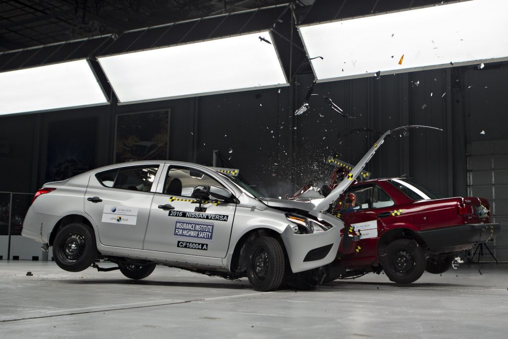 A Nissan Versa being crash tested by the IIHS