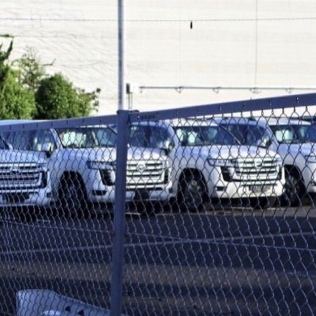 An image of a Toyota Land Cruiser pictured outside of a factory.