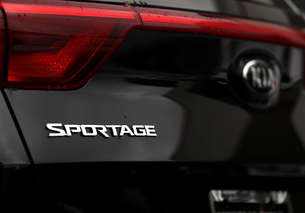 closeup of a Sportage badge