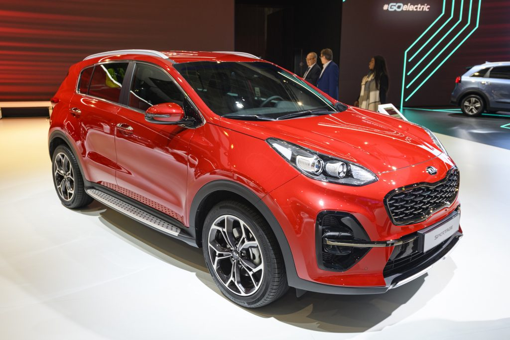 A red Kia Sportage compact SUV on display at Brussels Expo
