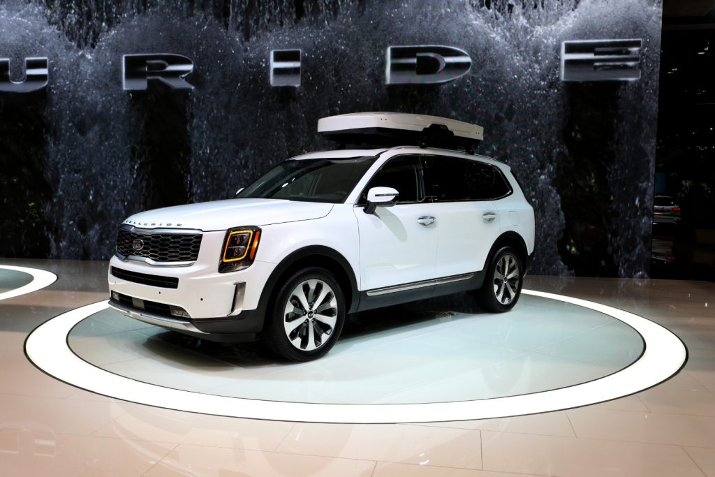 A white Kia Telluride sits on display at an auto show