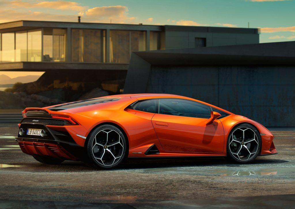 An image of an orange Lamborghini Huracan Evo parked outdoors.