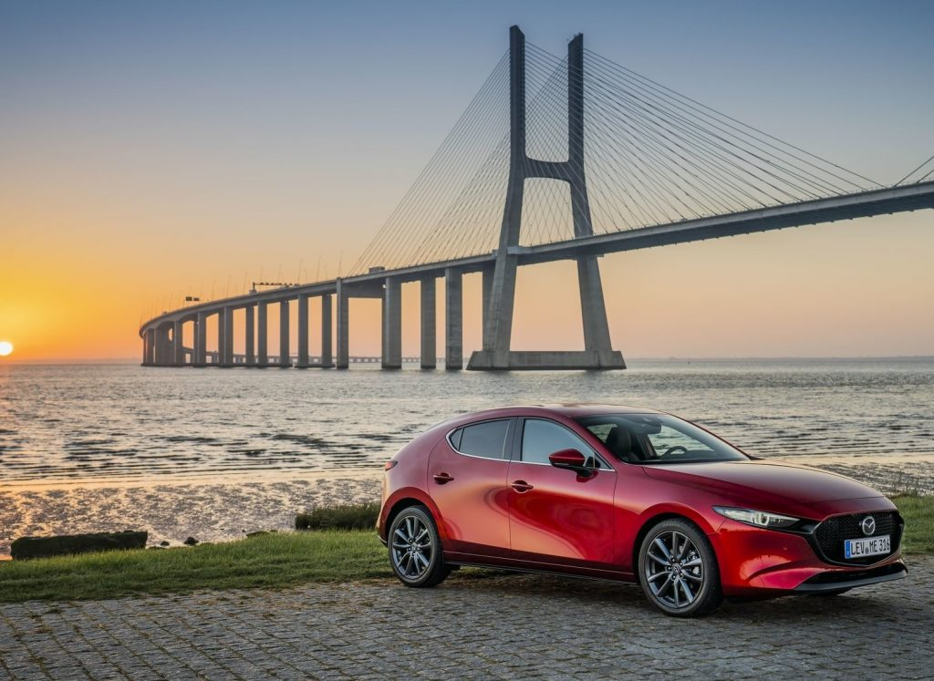 2020 Mazda3 sitting next to a bridge