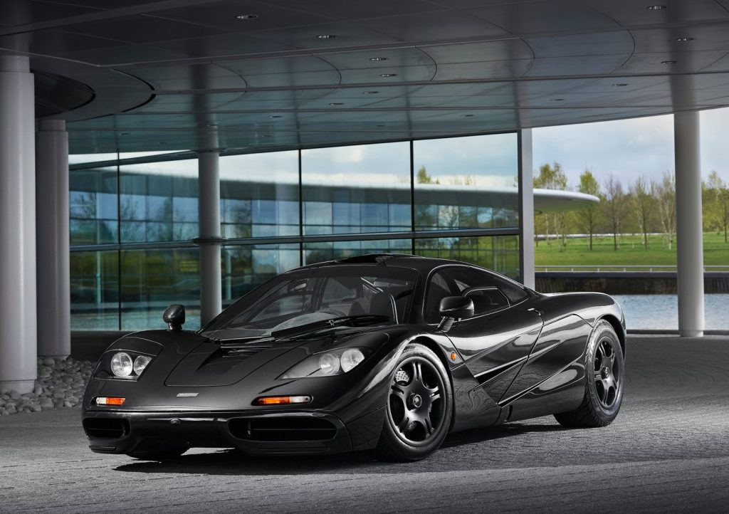 An image of a McLaren F1 parked outside.