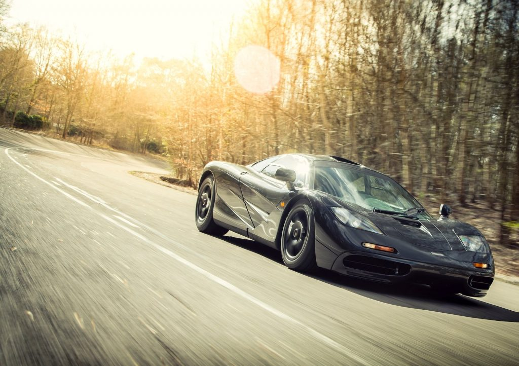 An image of a McLaren F1 out on the road.