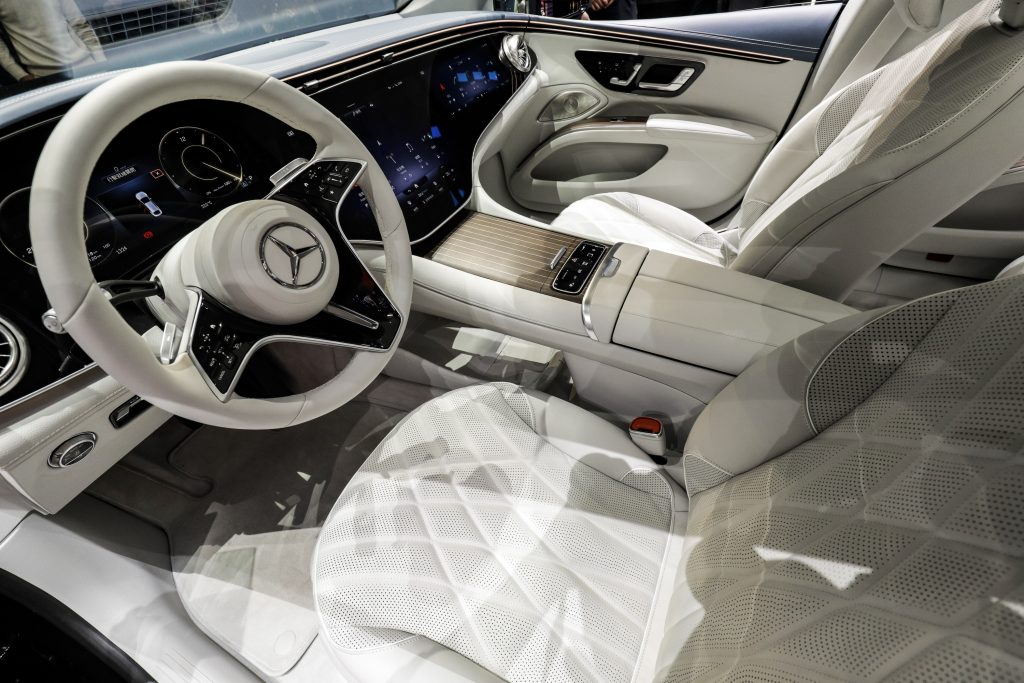 The white steering wheel of a Mercedes-Benz AG EQS electric sedan at the Auto Shanghai 2021 show