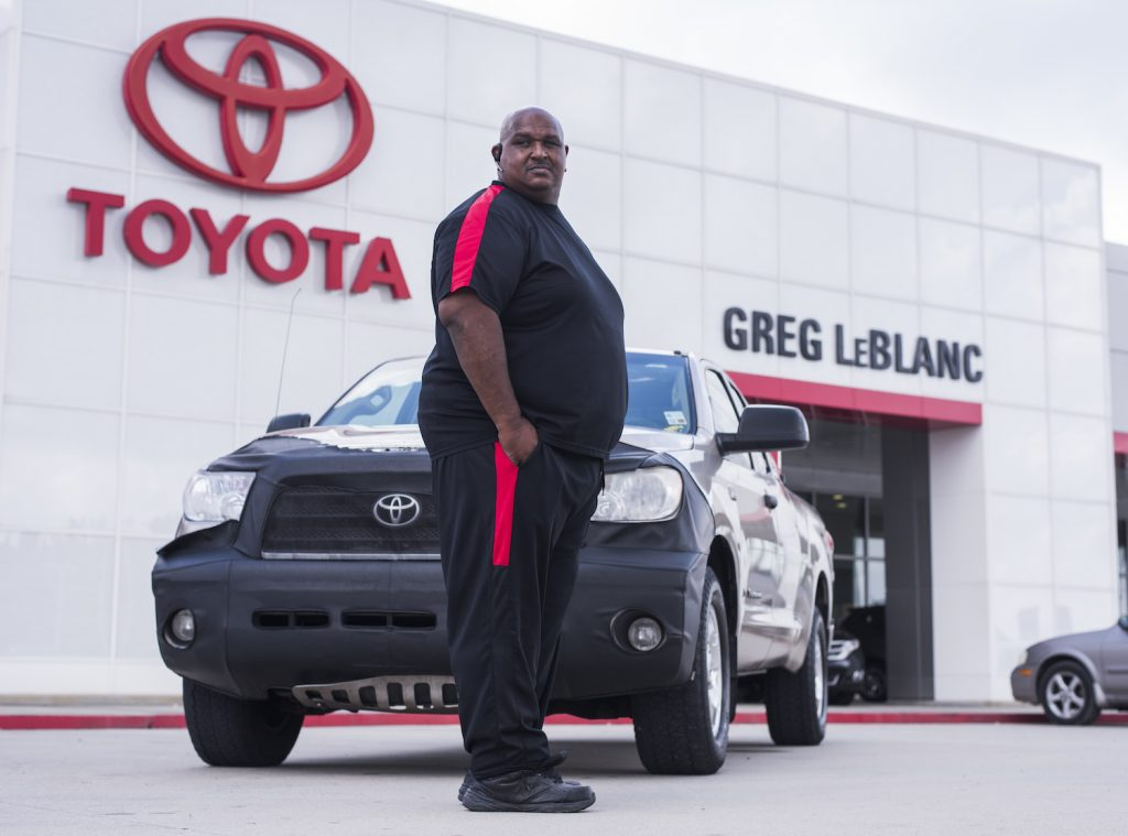 Victor Sheppard  pictured with his Toyota Tundra pickup in front of a Toyota dealership.