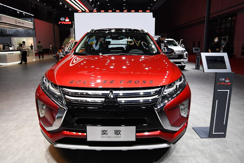 A red Mitsubishi Eclipse Cross car is displayed during the 19th Shanghai International Automobile Industry Exhibition