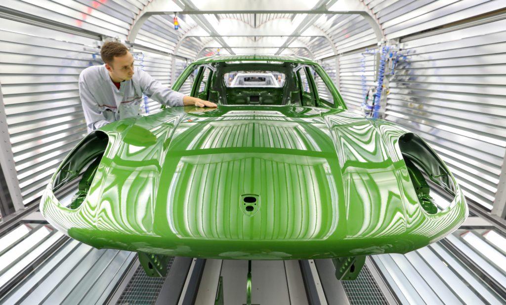 A bright green Porsche Macan on the assembly line