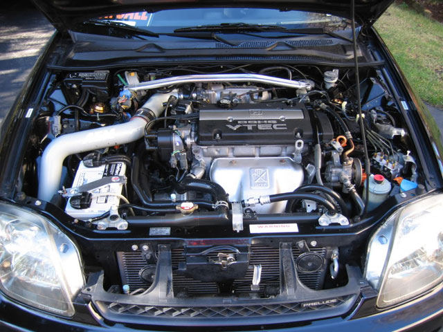 A picture of a non wire-tucked engine bay in a Honda Prelude