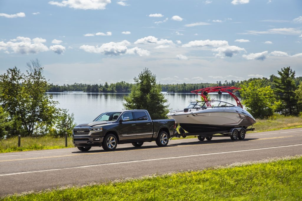 The 2021 Ram 1500 Limited EcoDiesel towing a boat behind it