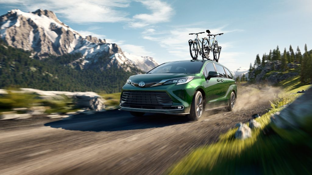 The 2021 Toyota Sienna driving on a dirt road