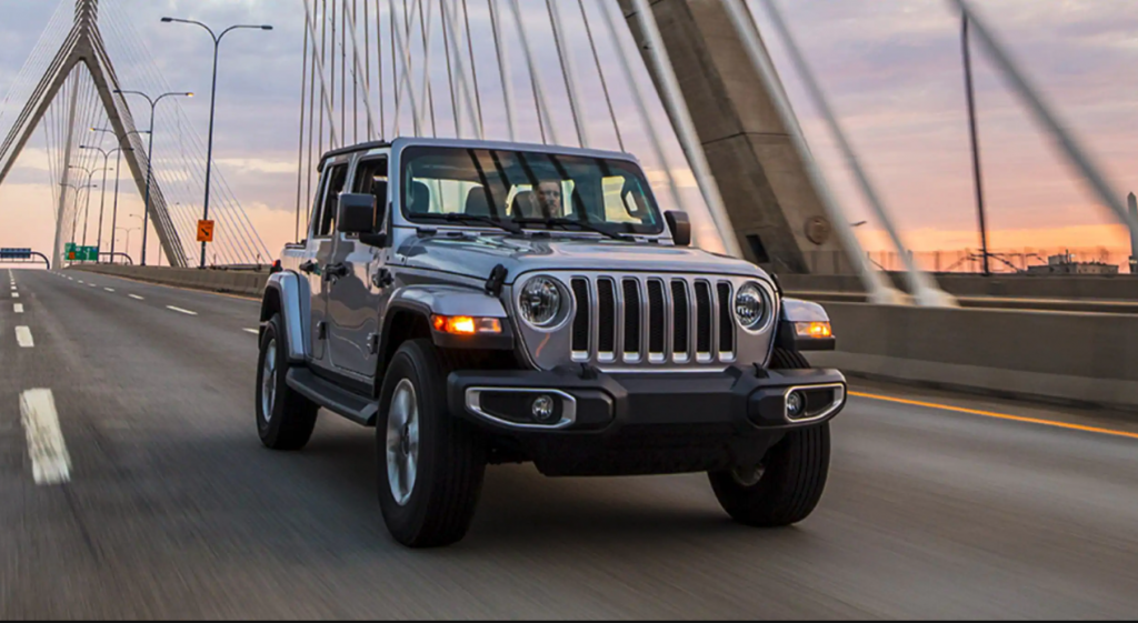The 2021 Jeep Wrangler Rubicon 392 driving on a bridge