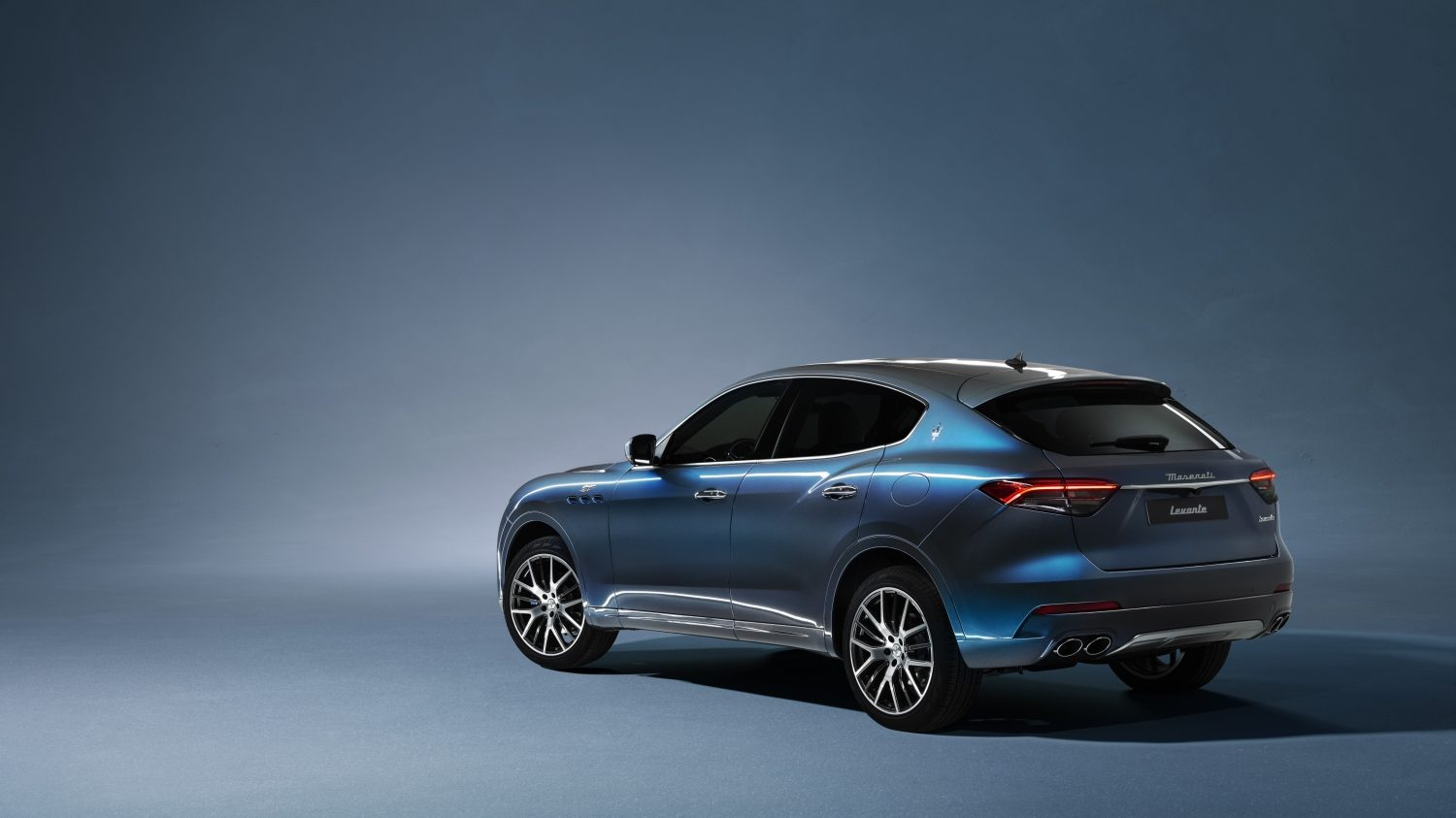 An image of a Maserati Levante Hybrid parked in a studio.