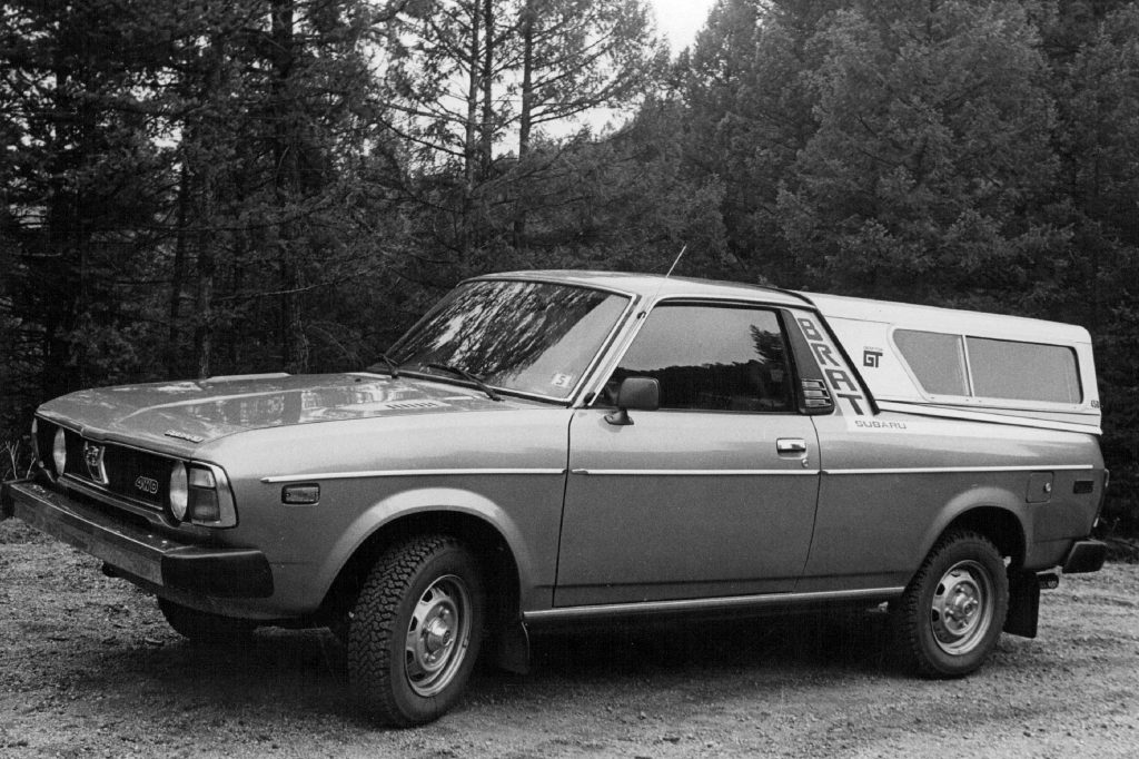 black and white photo of The Subaru Brat. It has rear-facing seats in Cargo Area
