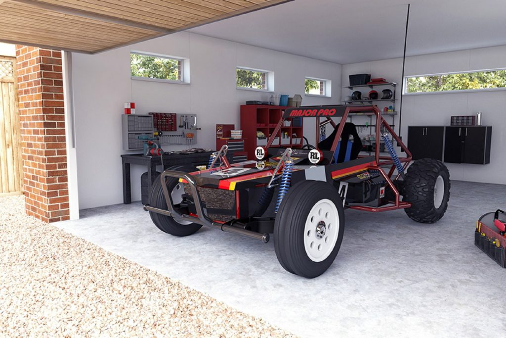 The black-and-red Tamiya Wild One MAX parked in a garage
