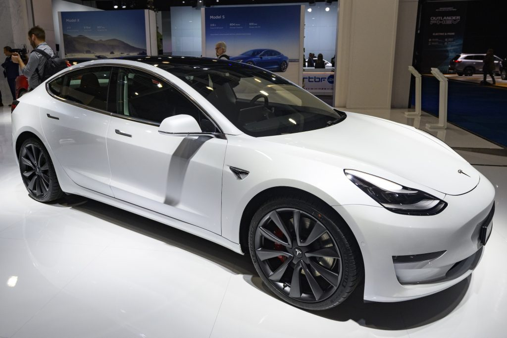 A white Tesla Model 3 compact EV on display at Brussels Expo on January 9, 2020, in Brussels, Belgium