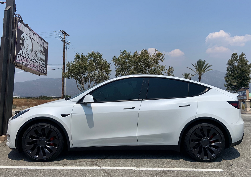 A Tesla Model Y with front tinted windows