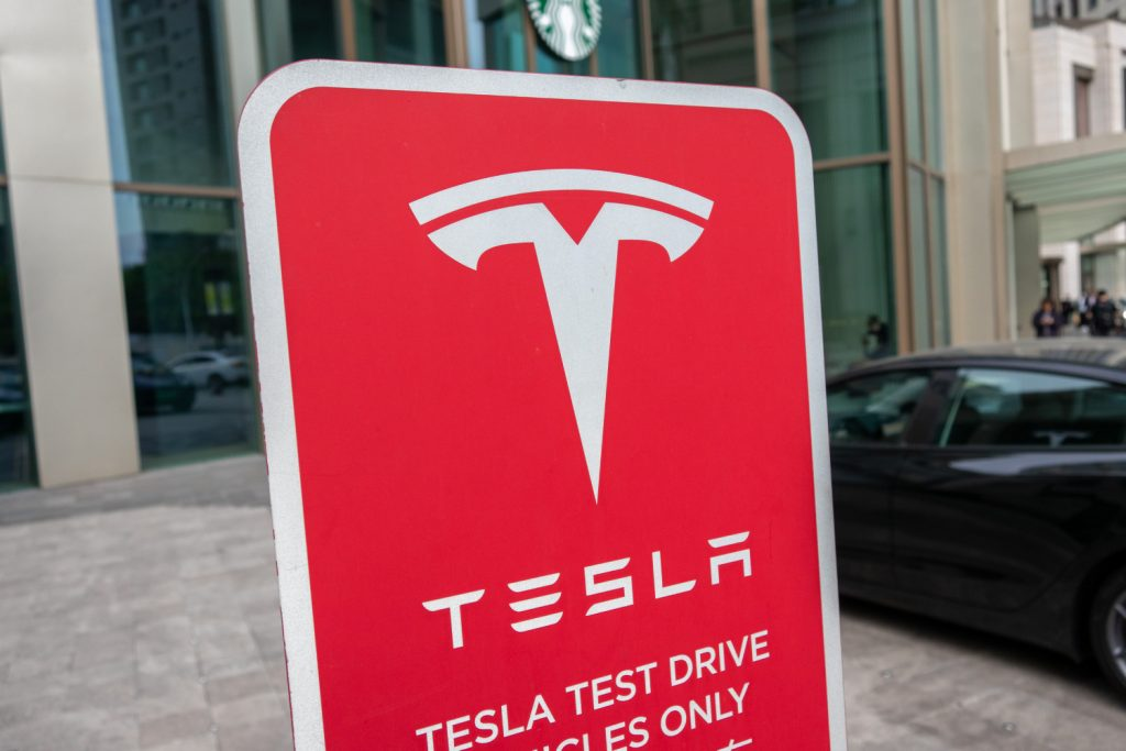 A Tesla electric vehicle test drive sign