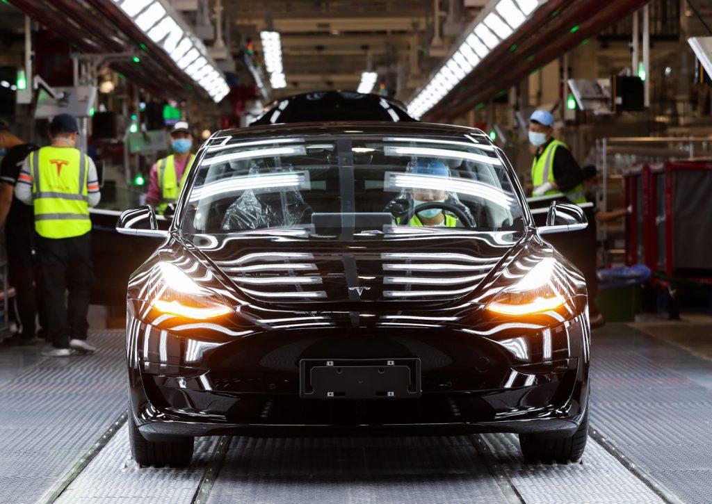 A Tesla Model 3 sits on the assembly line