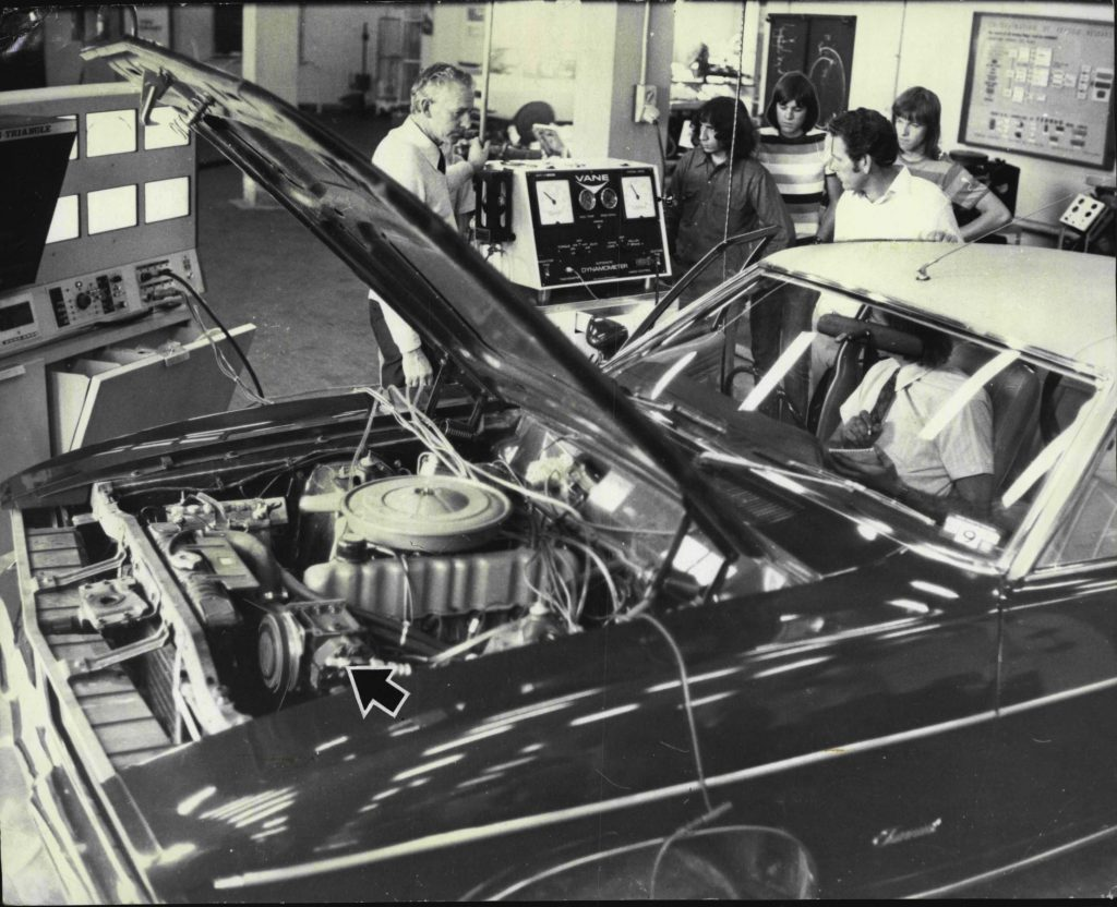 Testing the horsepower draw of the A/C (arrow-indicated) a 1975 Australian-market Ford Fairmont on a dynamometer