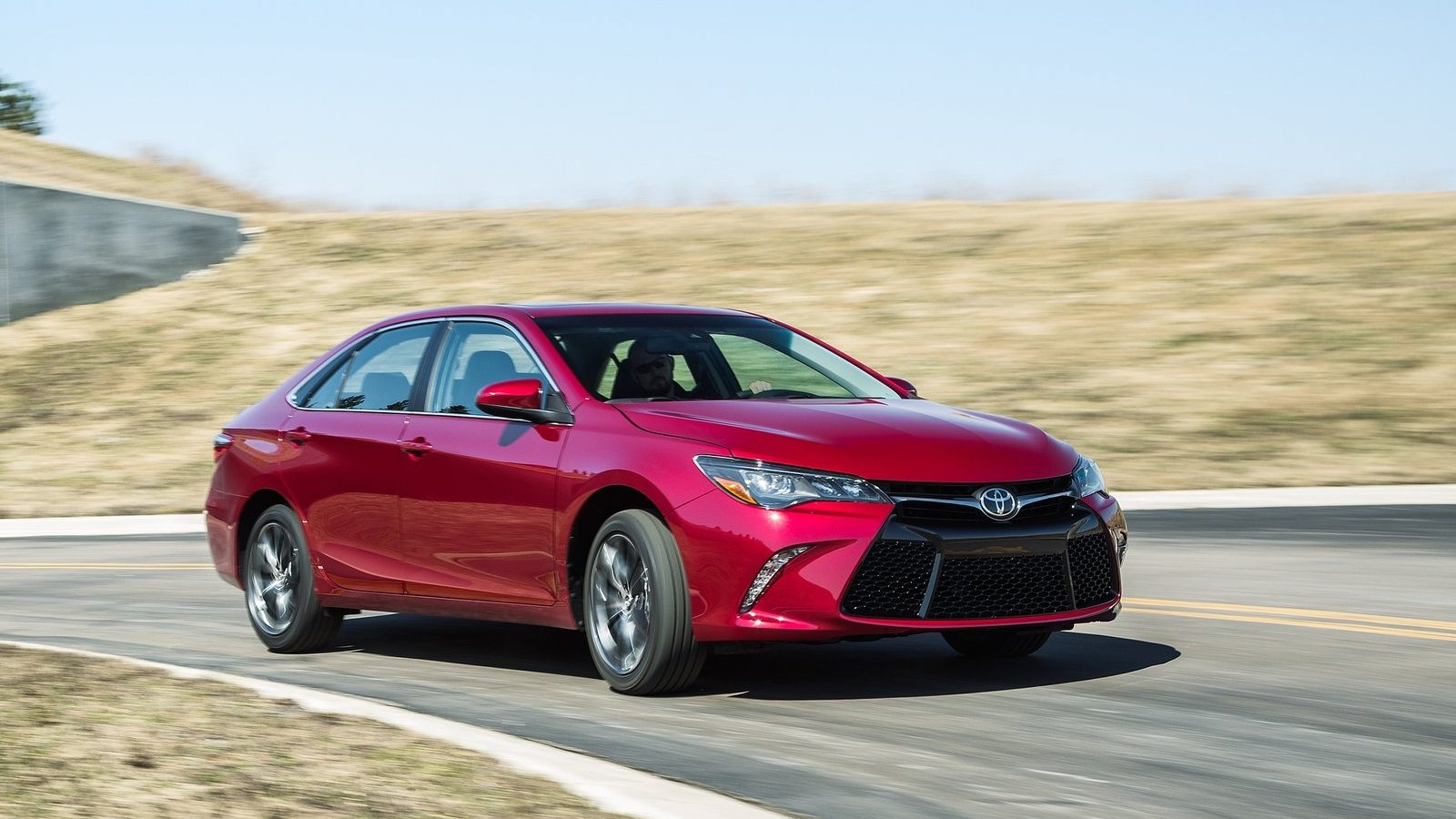 An image of a Toyota Camry outdoors, one of Consumer Reports' best used hybrid cars.