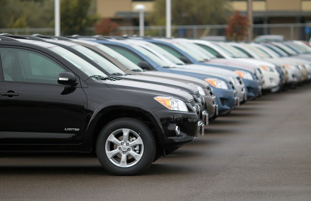A row of Toyota SUVs on display at a car dealership