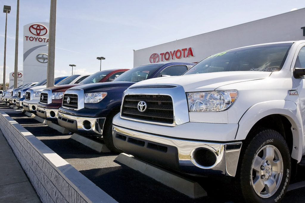 A lineup of Toyota Tundra full-size pickup trucks at a dealership