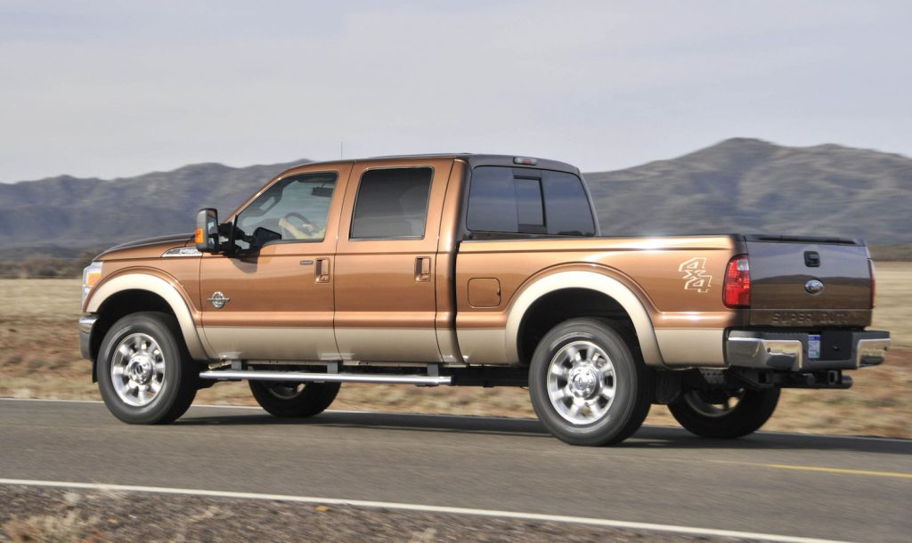 A 2011 Ford F250 diesel pickup truck being driven by a mountain range.